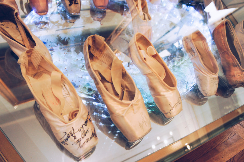 Pointe shoes of famous ballerinas with their autographs